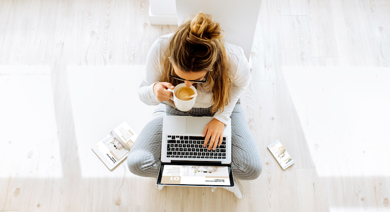 top view of woman working on website blog drinking coffee